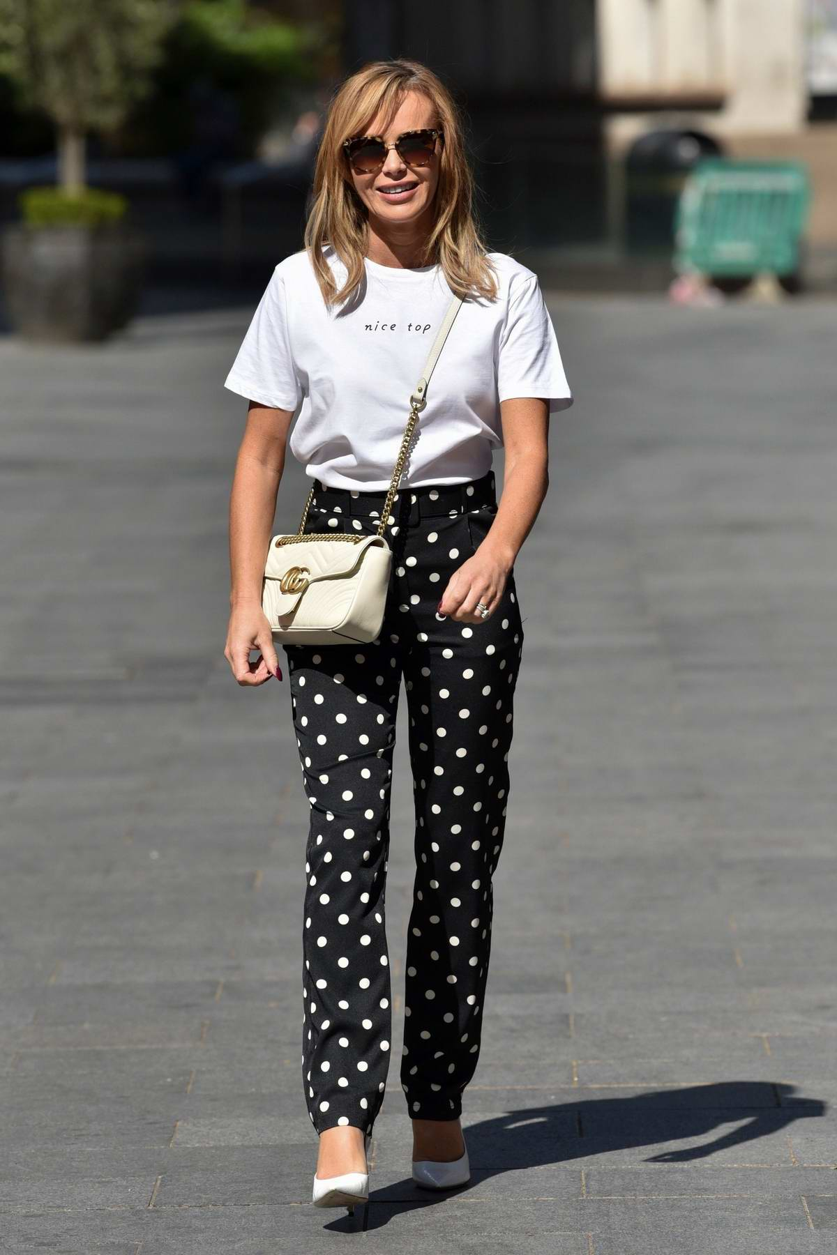 Amanda Holden dons polka dot pants as she leaves Global Radio Studios in London, UK