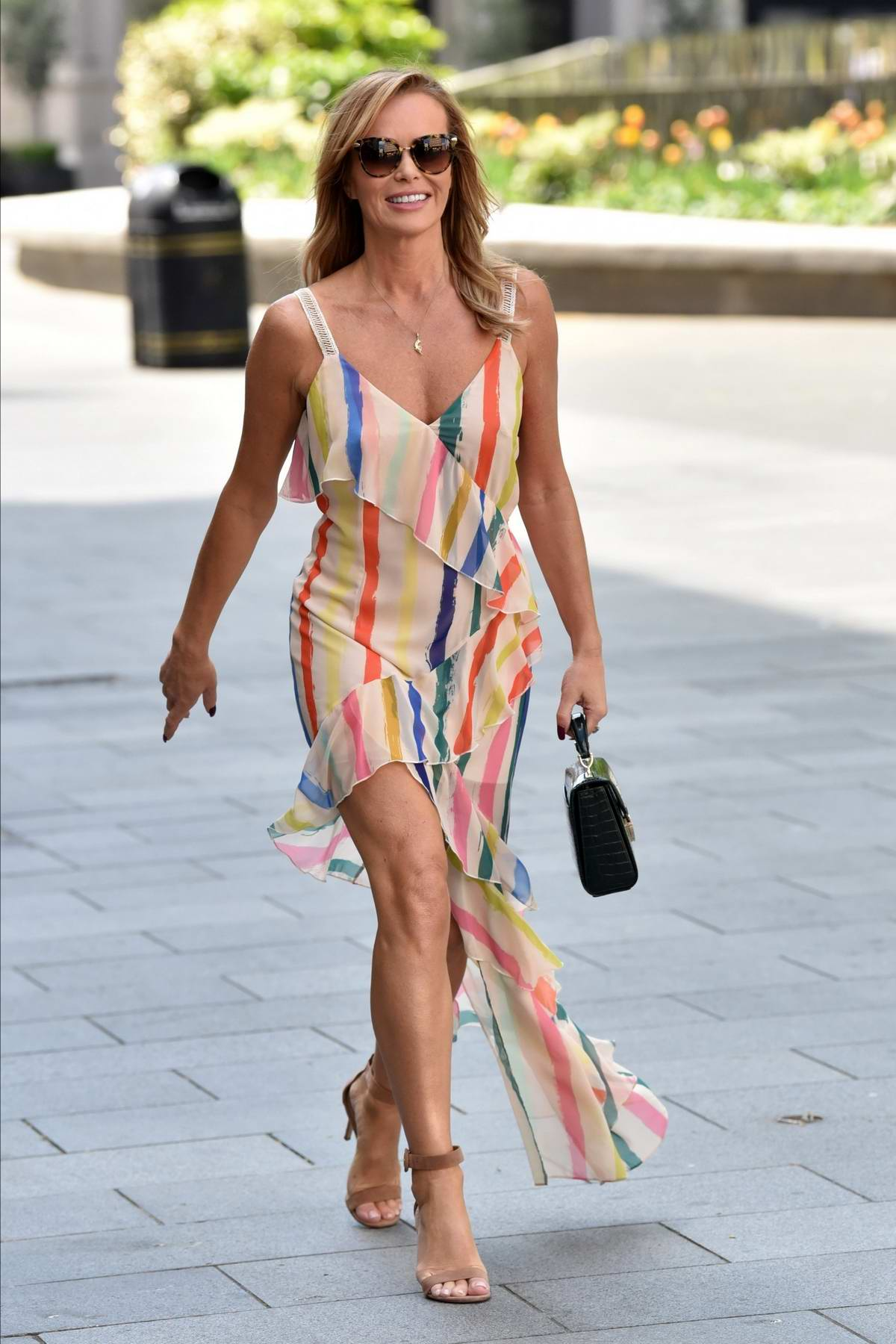 Amanda Holden looks great in colorful stripes while leaving the Heart Radio in London, UK