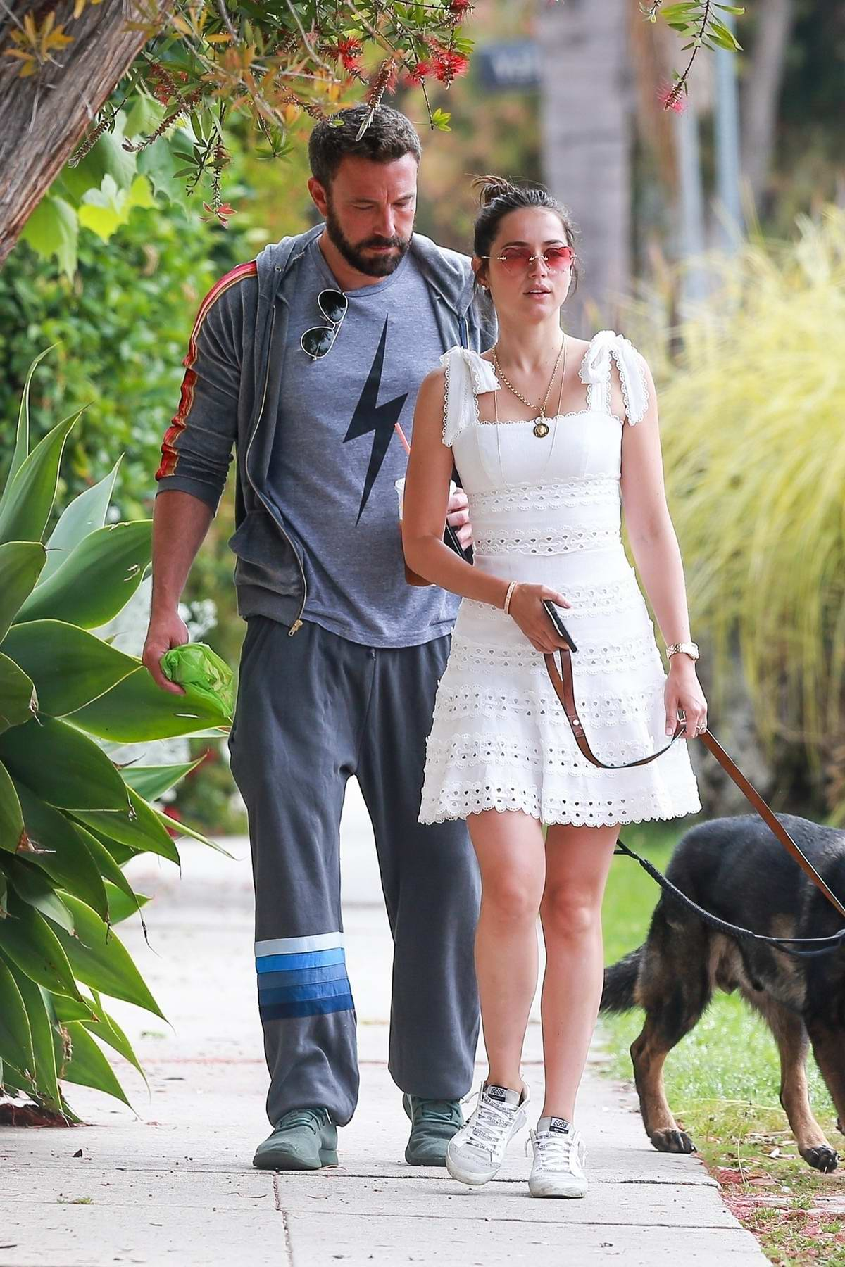 Ana de Armas looks cute in a white mini dress and rose-colored sunglasses while out for a stroll with Ben Affleck in Venice, California