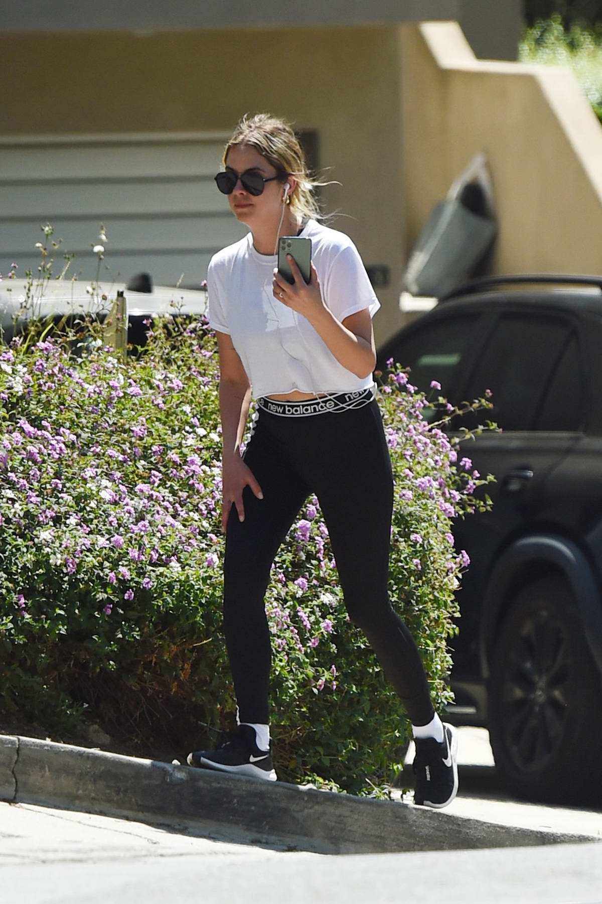 Ashley Benson chats on her phone while out for an afternoon hike in Los Angeles