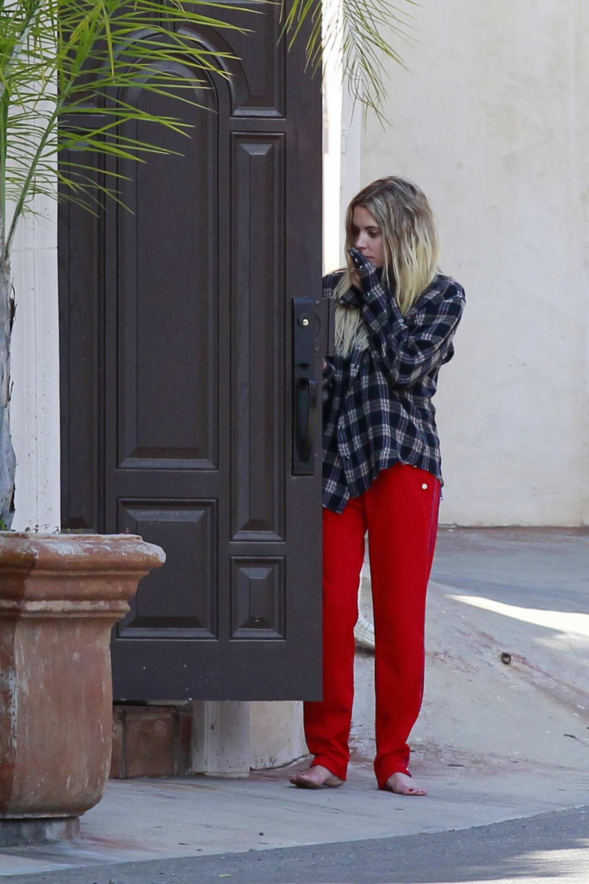 Ashley Benson goes barefoot with bright red pants as she stepped out of G-Eazy's house in Los Angeles