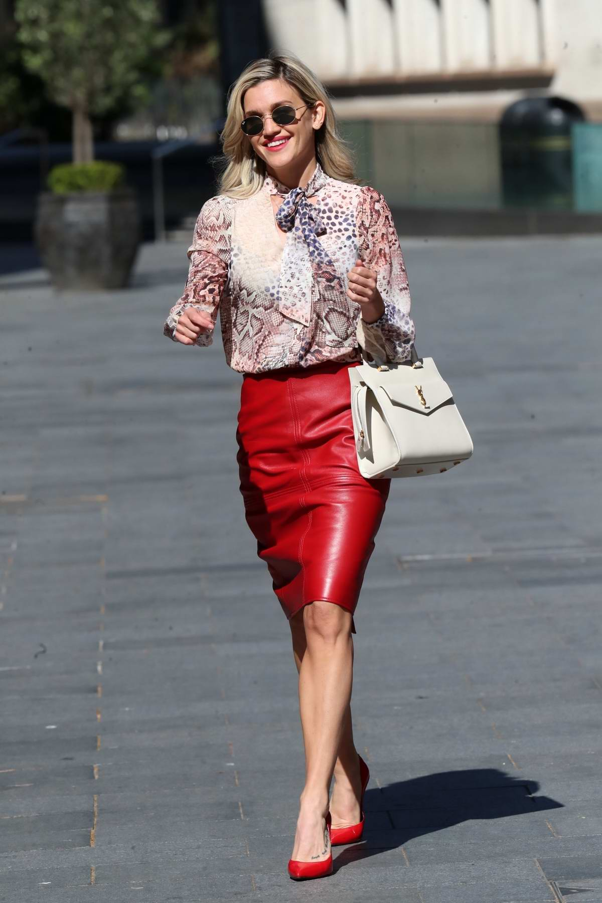 Ashley Roberts looks chic in red pencil skirt and print top while leaving the Global Studios in London, UK