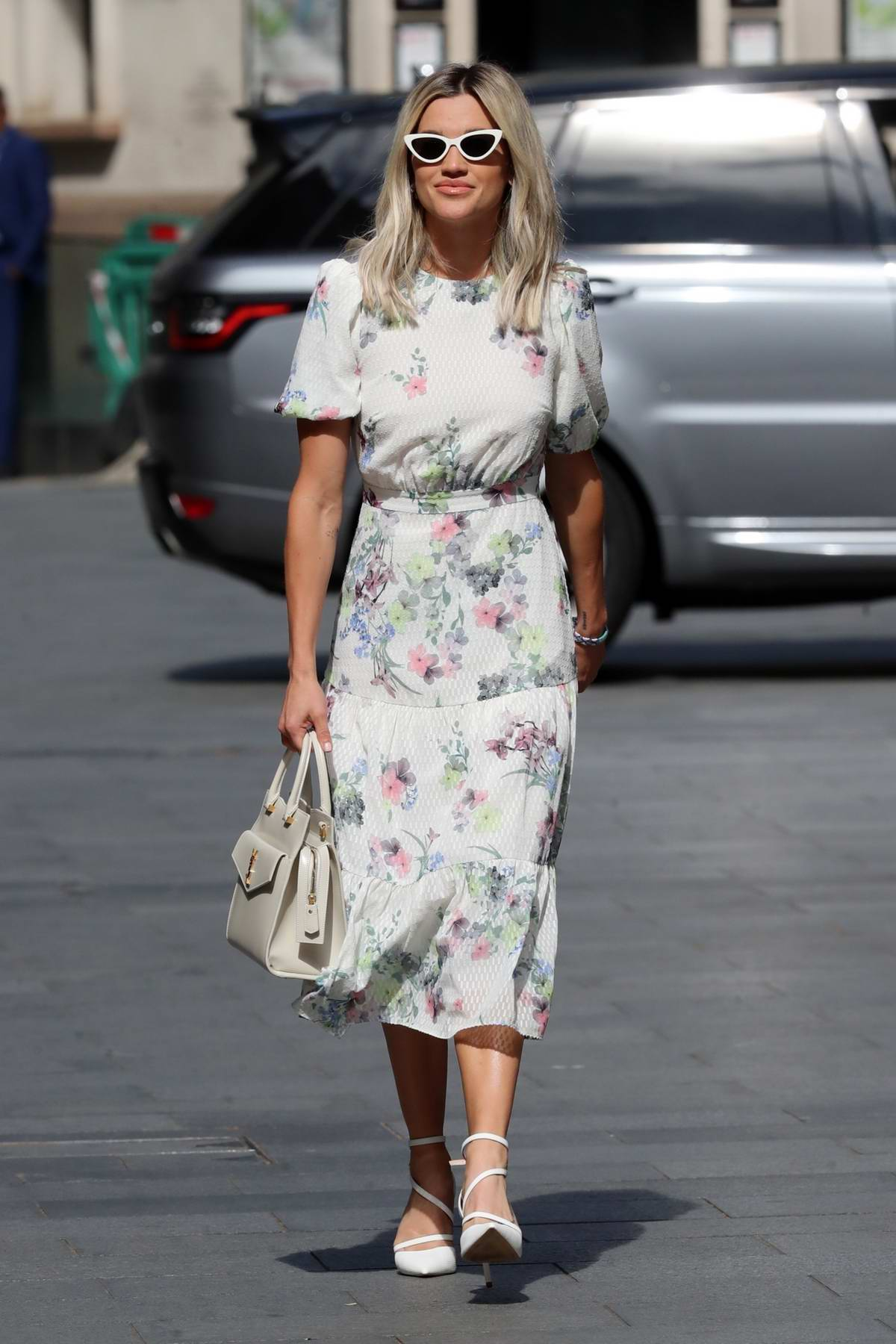 Ashley Roberts looks great in a floral print dress as she leaves the Global Radio studios in London, UK