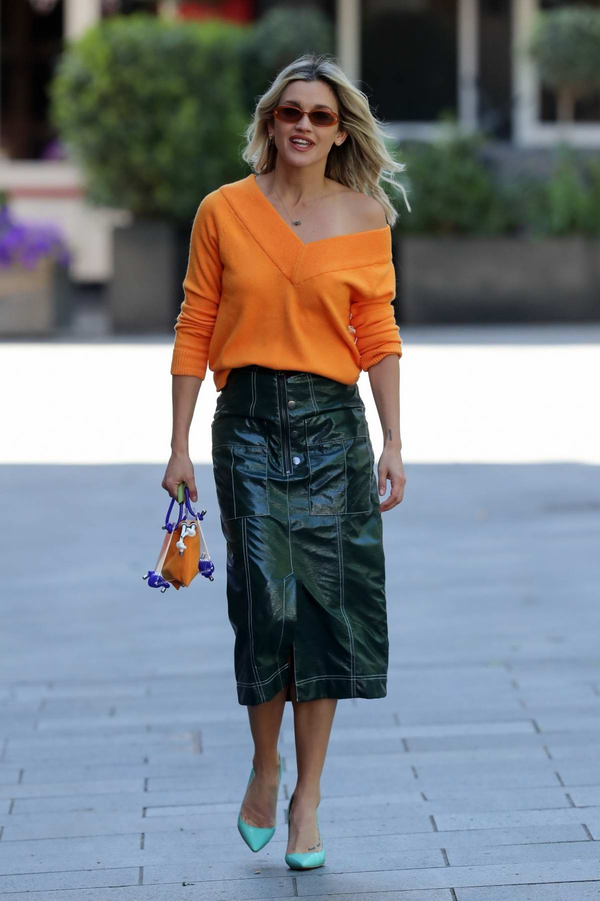 Ashley Roberts looks stylish in an orange jumper and green skirt as she leaves the Global studios in London, UK