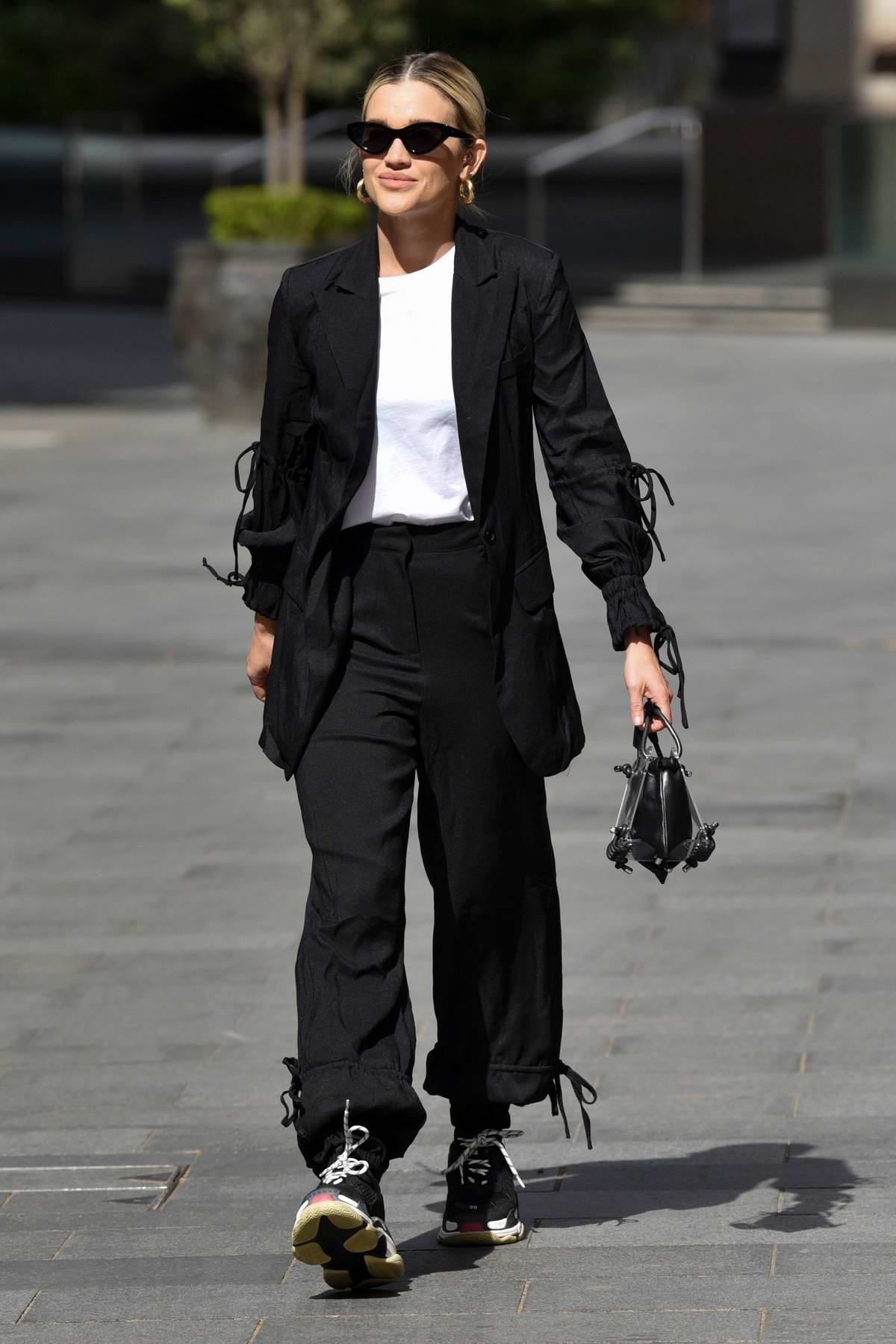Ashley Roberts seen wearing black pantsuit as she leaves after her Heart Radio show in London, UK