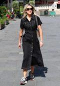 Ashley Roberts wears a black denim dress as she leaves Heart Radio in London, UK