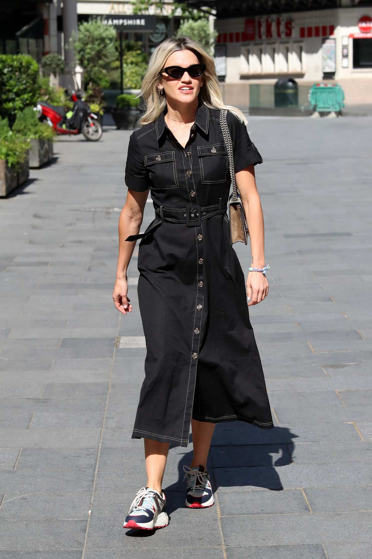 Ashley Roberts wears a black denim dress as she leaves Heart Radio in London, UK