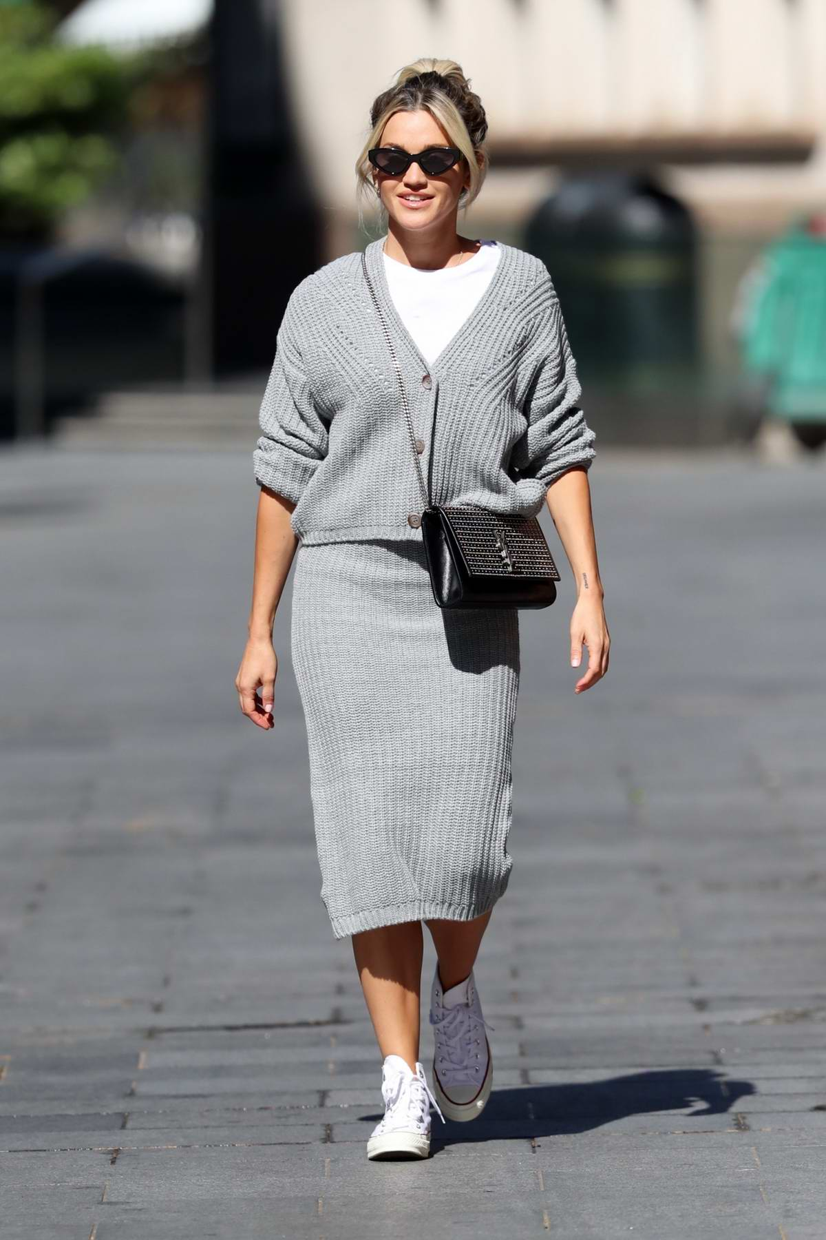 Ashley Roberts wears a grey knitted top and skirt while leaving the Heart Radio Studios in London, UK