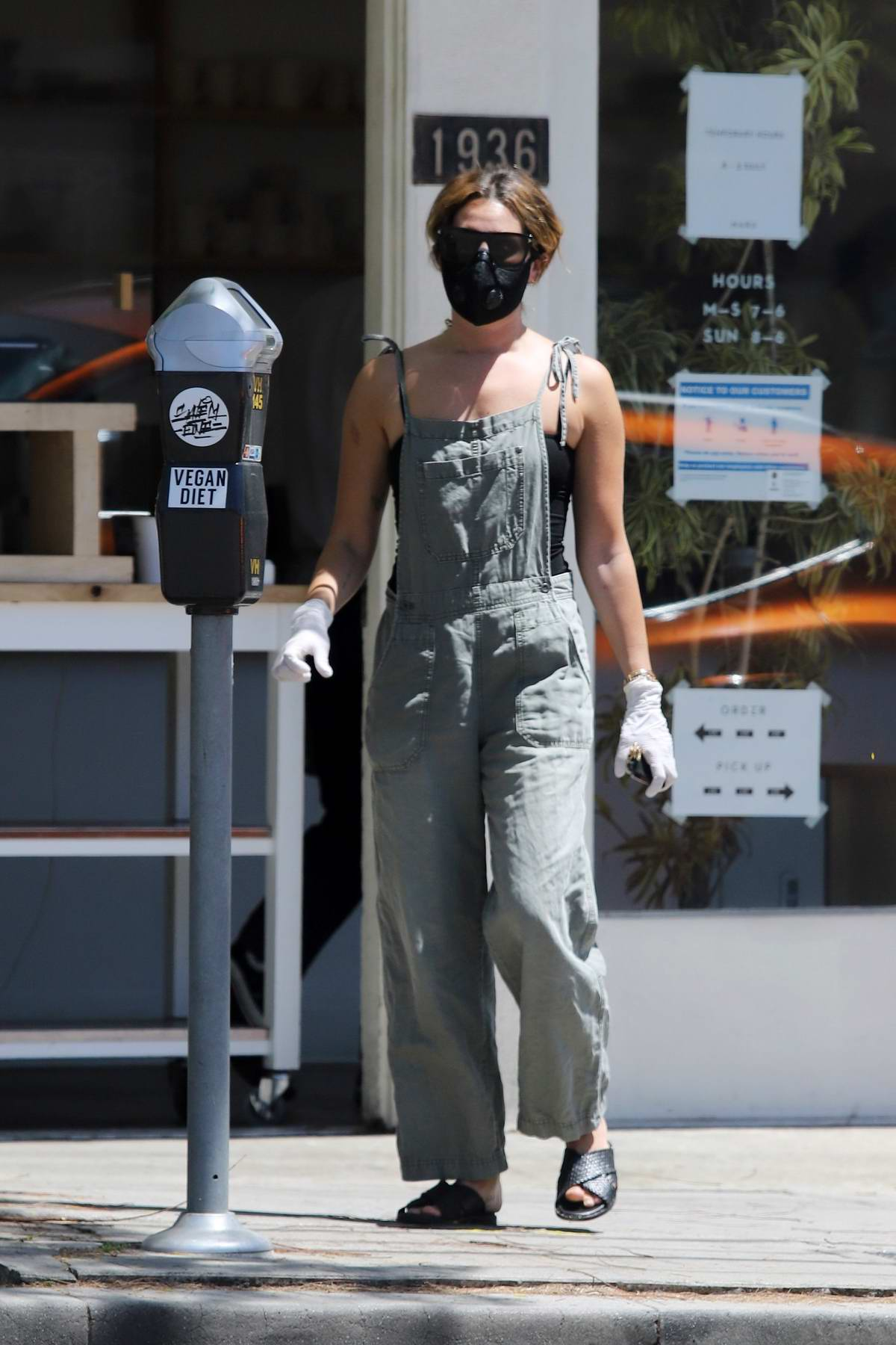 Ashley Tisdale seen wearing mask and gloves during a coffee run in Los Angeles