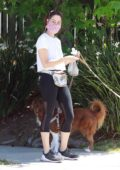 Aubrey Plaza sports a white top and black leggings while out walking her dogs in Los Feliz, California
