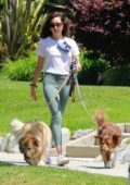 Aubrey Plaza sports a white top and green leggings while out walking her dogs in Los Feliz, California