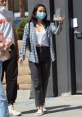 Camila Mendes stops for an iced coffee before heading out with friends in West Hollywood, California