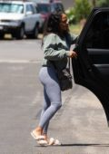 Christina Milian sports a green sweatshirt and grey leggings while out with her kids in Los Angeles