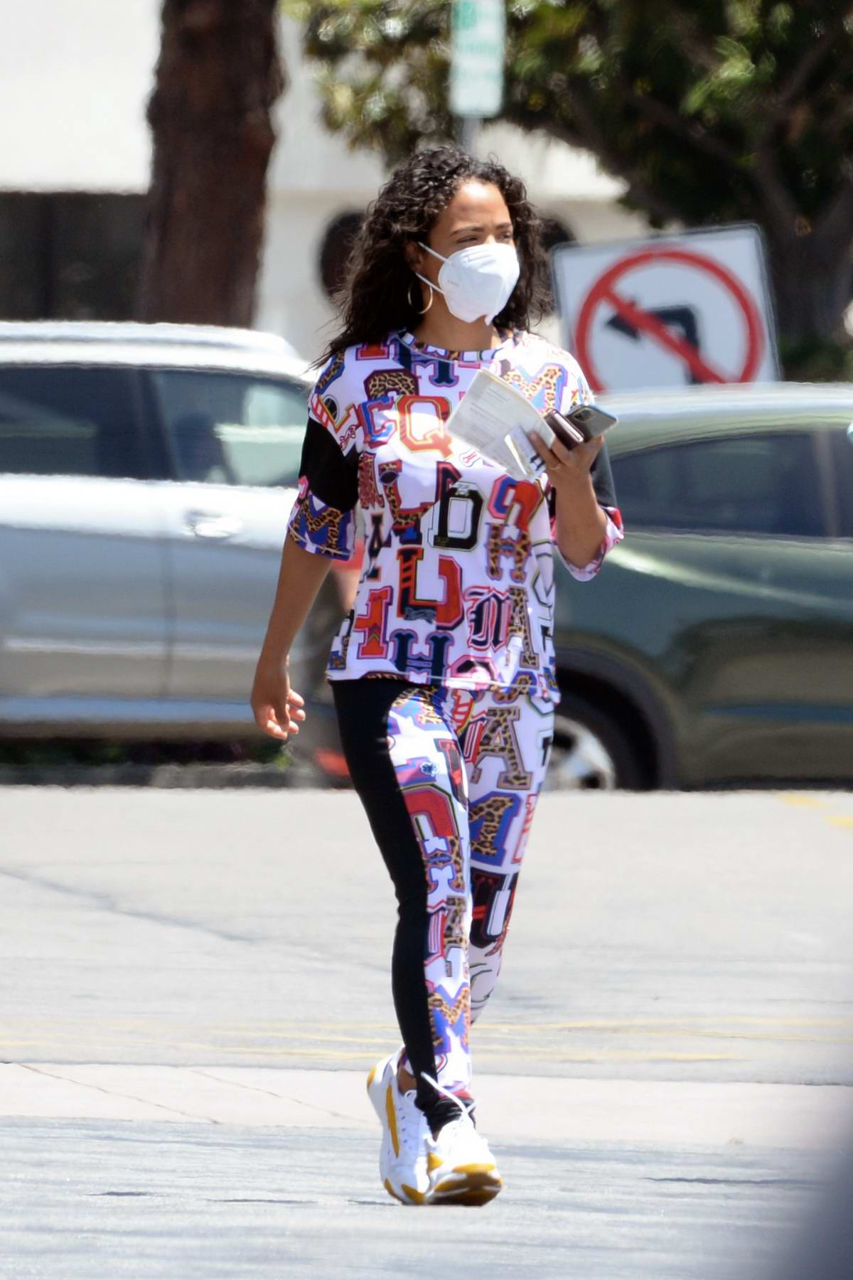 Christina Milian wears a colorful outfit while out running errands in Los Angeles