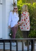 Dakota and Elle Fanning stop by to check on the remodeling progress of their new house in Los Angeles