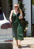 Dakota Fanning seen moving boxes into a car with her mother in Los Angeles
