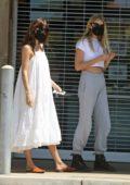 Dakota Johnson enjoys a ride with Chris Martin's daughter Apple in Malibu, California