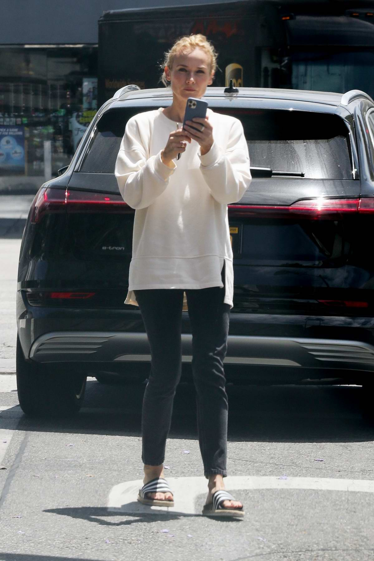 Diane Kruger looked busy on her phone while out shopping in Los Angeles