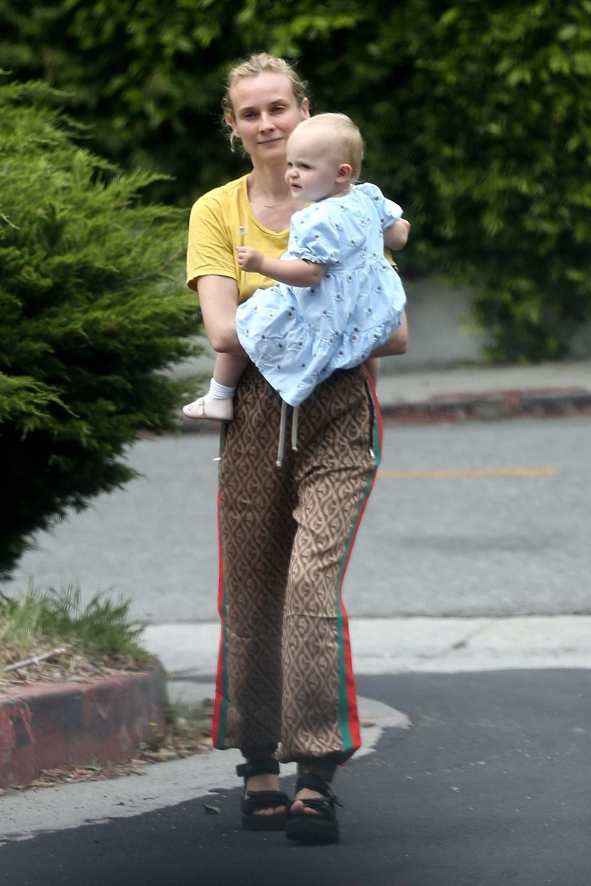 Diane Kruger takes her daughter out for some fresh air around the neighborhood in Los Angeles