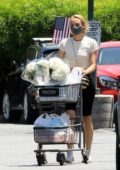 Diane Kruger wears a protective mask as she picks up some flowers and groceries at Bristol Farms in Los Angeles