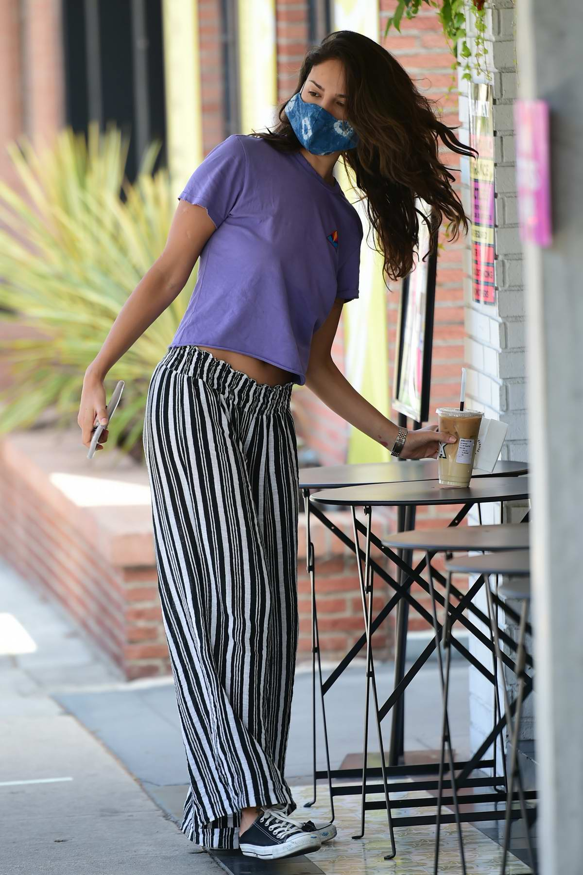 Eiza Gonzales wears purple top with striped pants as she steps out for a coffee at Alfred's in Los Angeles