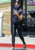 Eiza Gonzalez rocks a black crop top and leggings as she goes out for an iced coffee in Beverly Hills, California