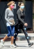 Elisabetta Canalis steps out for a power walk with a friend in Beverly Hills, California
