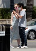 Elle Fanning and Max Minghella gets all loved-up while taking selfies during their stroll in Los Angeles