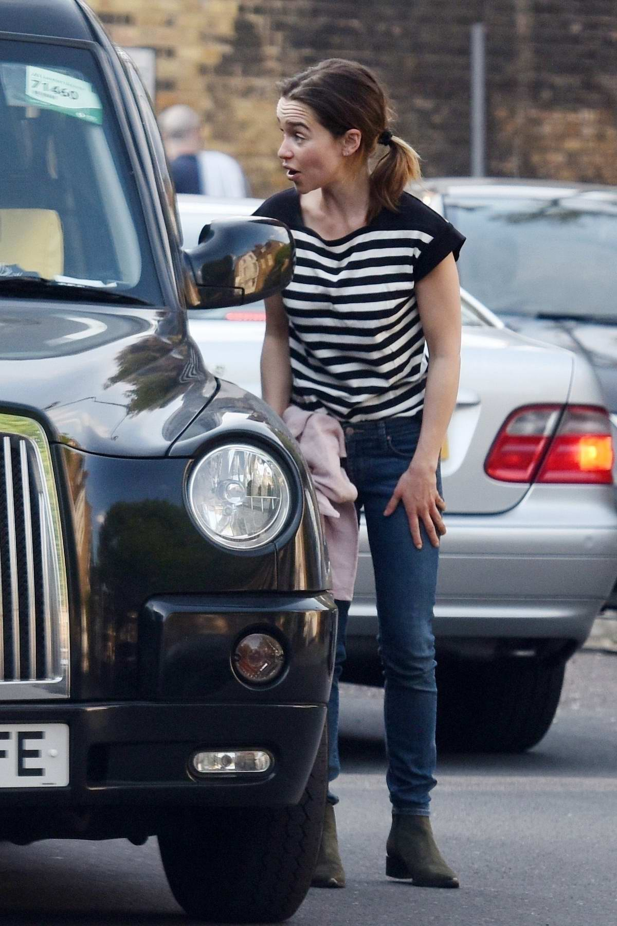 Emilia Clarke seen asking a cab driver to deliver a package in London, UK