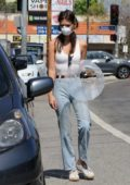 Emily Ratajkowski picks up her dog Colombo from the vet with a friend in Los Angeles