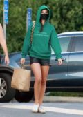 Emily Ratajkowski rocks a green hoodie during a grocery run at Gelson's in Los Feliz, California