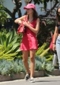 Emily Ratajkowski wears a red mini dress while out to walk her dog with her husband in Los Feliz, California
