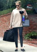 Emma Roberts has her hands full while visiting a friend in Los Angeles