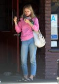 Erin Moriarty checks her messages on her phone while waiting for her take-out at Kings Road Cafe in Hollywood, California