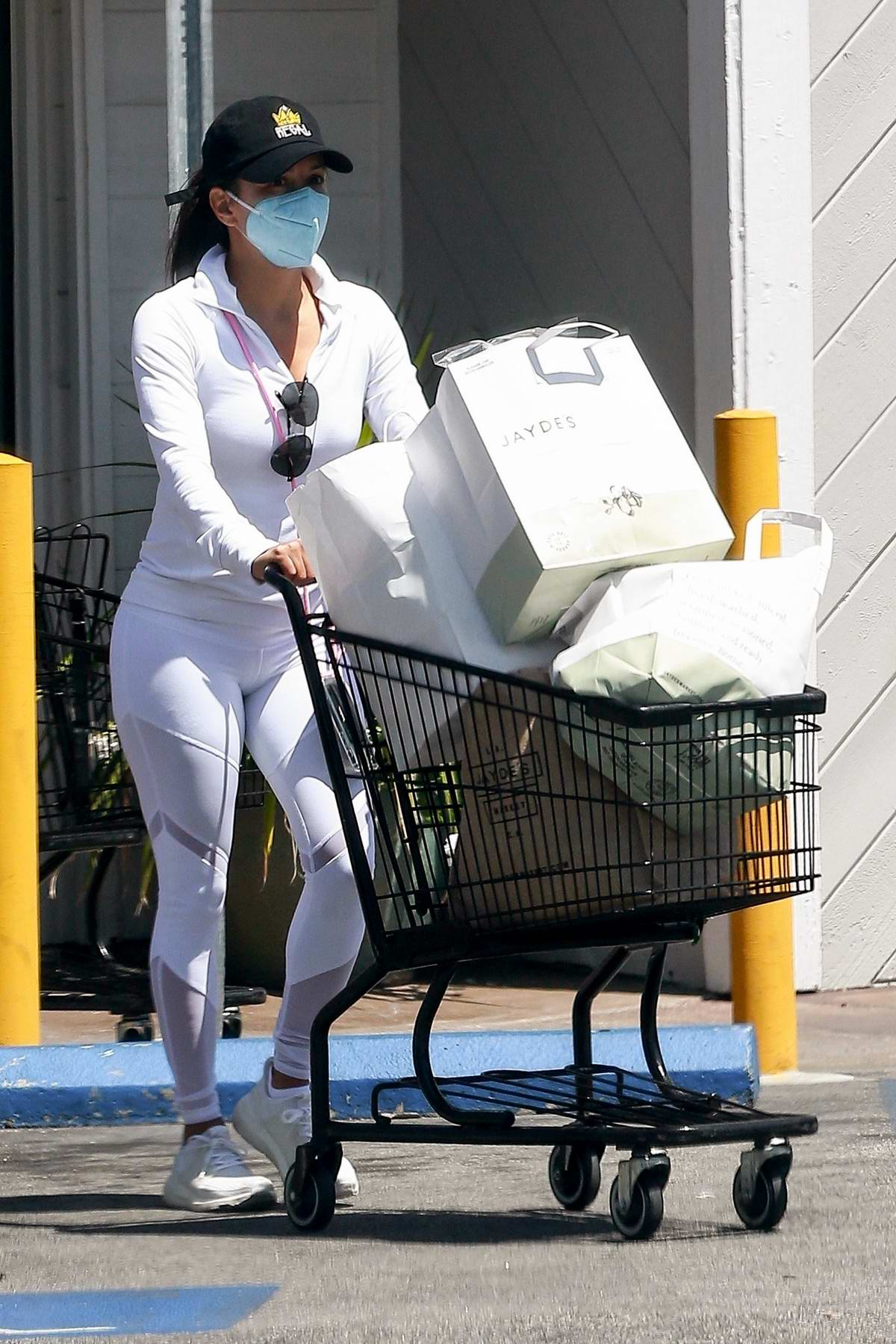 Eva Longoria dons all-white athleisure while shopping groceries at Jayde's market in Los Angeles