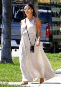 Eva Longoria wears a white maxi dress as she goes house hunting with husband Jose Baston in Beverly Hills, California