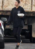 Georgia Fowler sports a black hoodie and leggings as she grab some food in Sydney, Australia