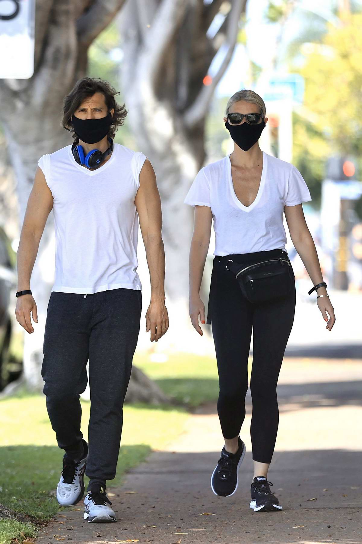 Gwyneth Paltrow enjoys a stroll in the sunshine with husband Brad Falchuk in West Hollywood, California