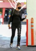 Hailey Bieber rocks all-black with Nike Air Jordan 1s while visiting a dermatologist office in Beverly Hills, California