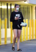 Ireland Baldwin wears a mask with a Nike sweatshirt and shorts while out to pick up some essentials in Los Angeles