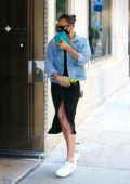 Irina Shayk covers her face as she heads to a friend's apartment on Memorial Day, New York City
