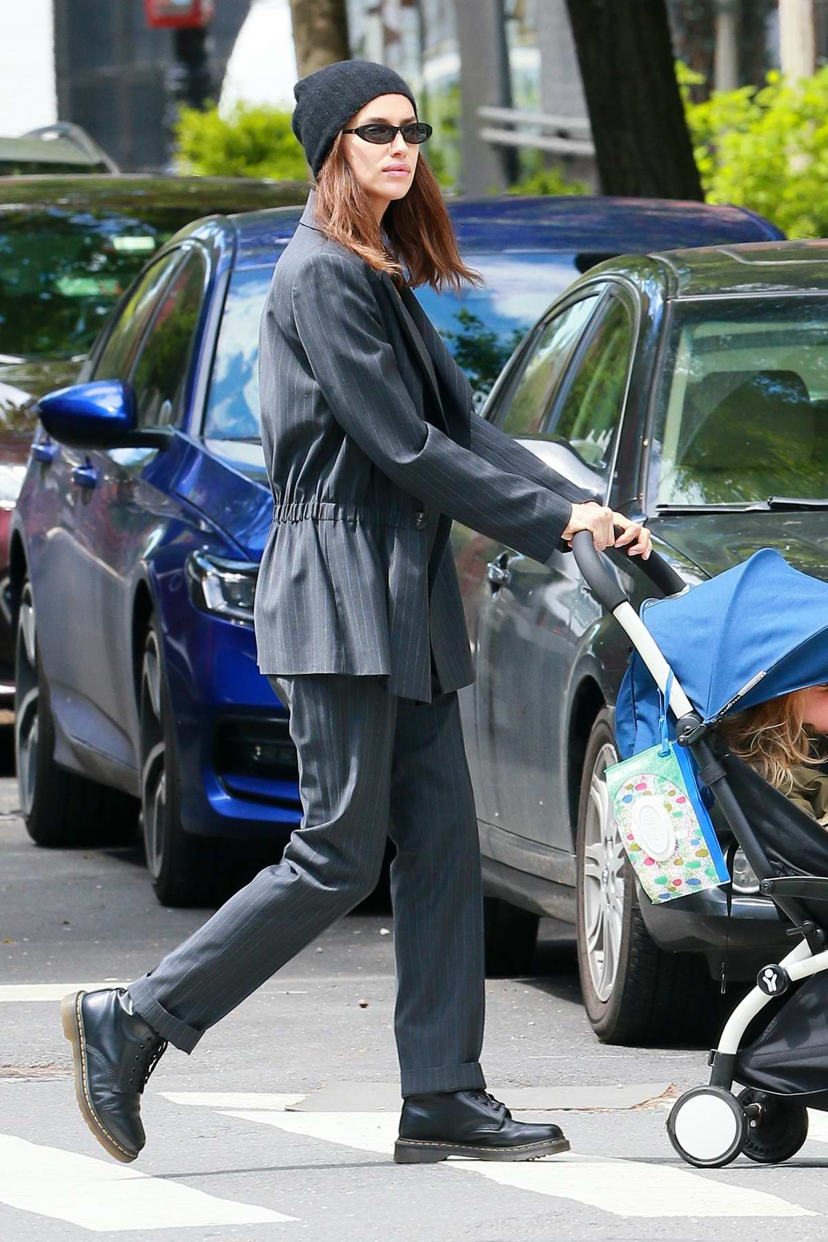 Irina Shayk looks chic in a striped blazer while pushing her daughter Lea around in a stroller in New York City