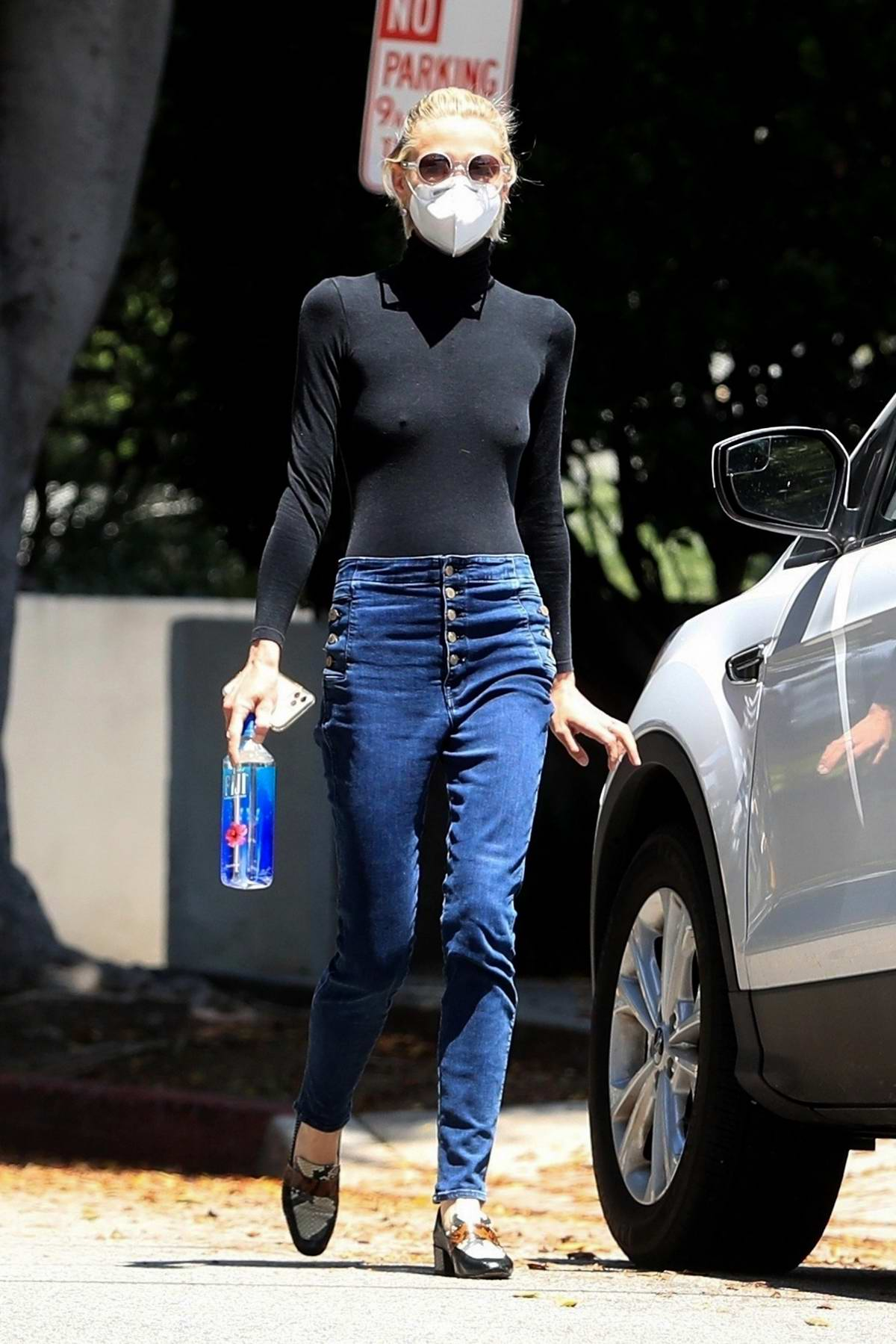 Jaime King wears a black turtleneck as she leaves a doctor's appointment in Santa Monica, California