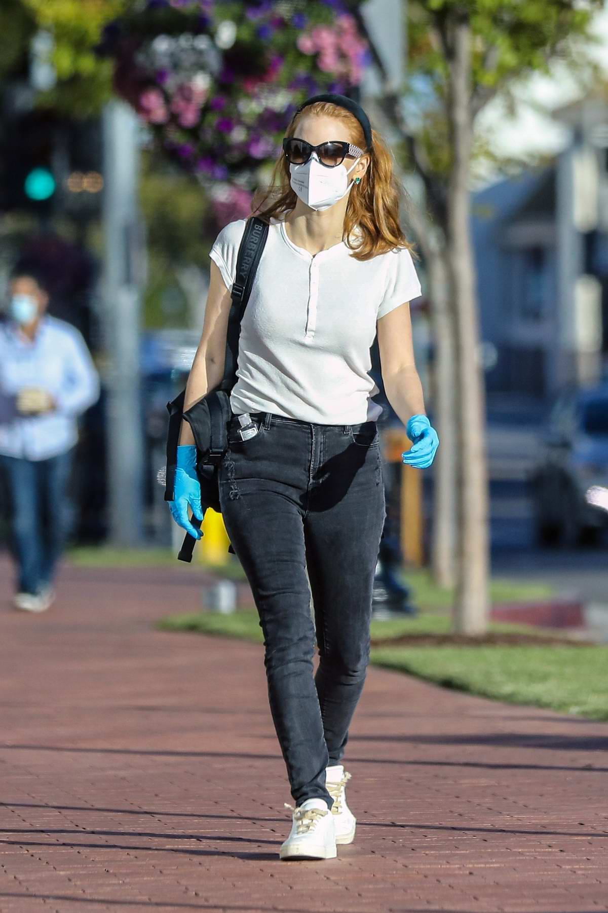Jessica Chastain seen wearing mask and gloves during a grocery run at Erewhon in Pacific Palisades, California