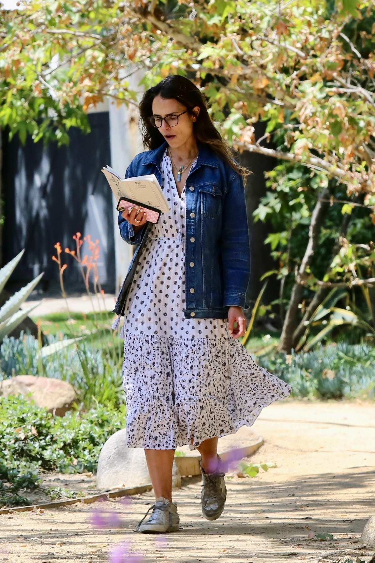 Jordana Brewster enjoys an afternoon stroll while reading a book in Brentwood, California
