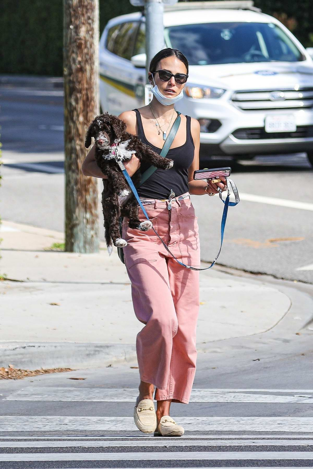 Jordana Brewster makes a coffee run with her new pup in Brentwood, California