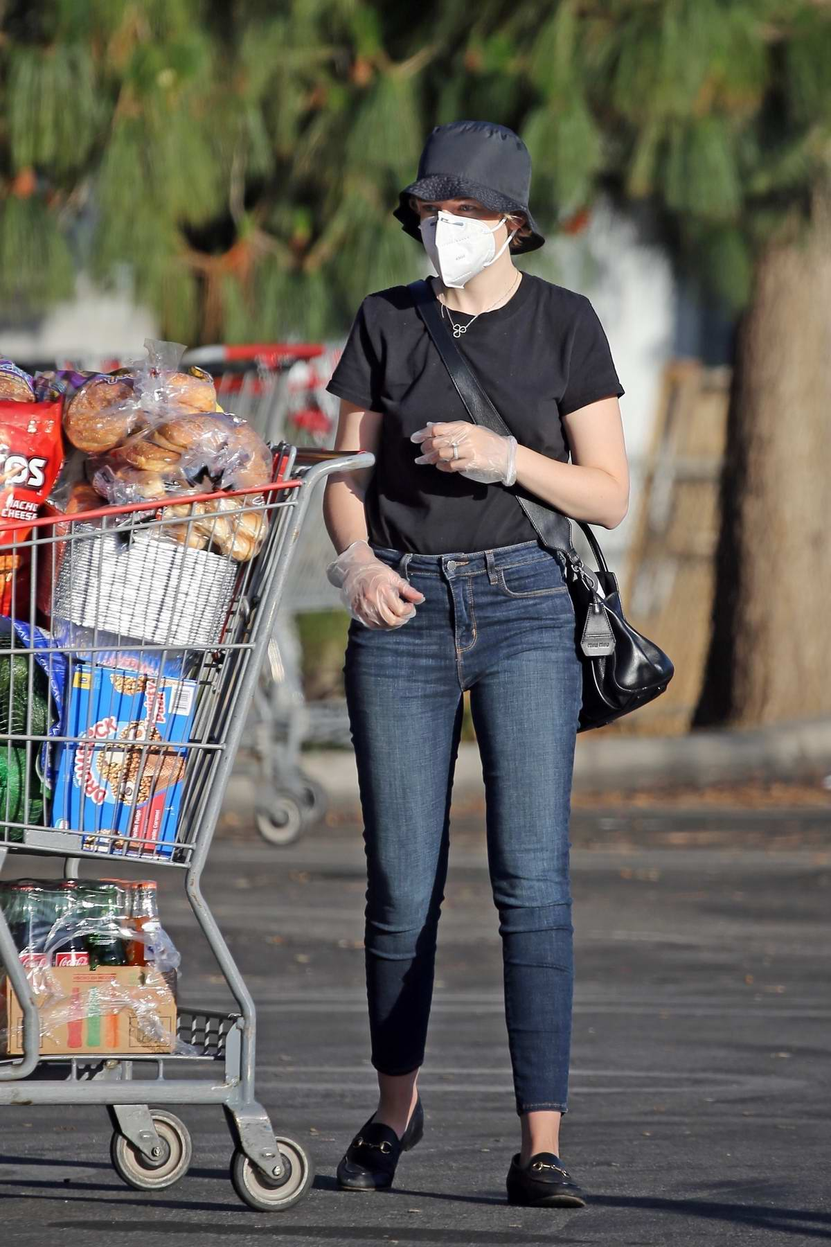 Julia Garner and Mark Foster stock up on groceries at Costco in Los Angeles