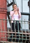 Karlie Kloss and Joshua Kushner share a kiss on their balcony while cheering for the frontline workers of New York City