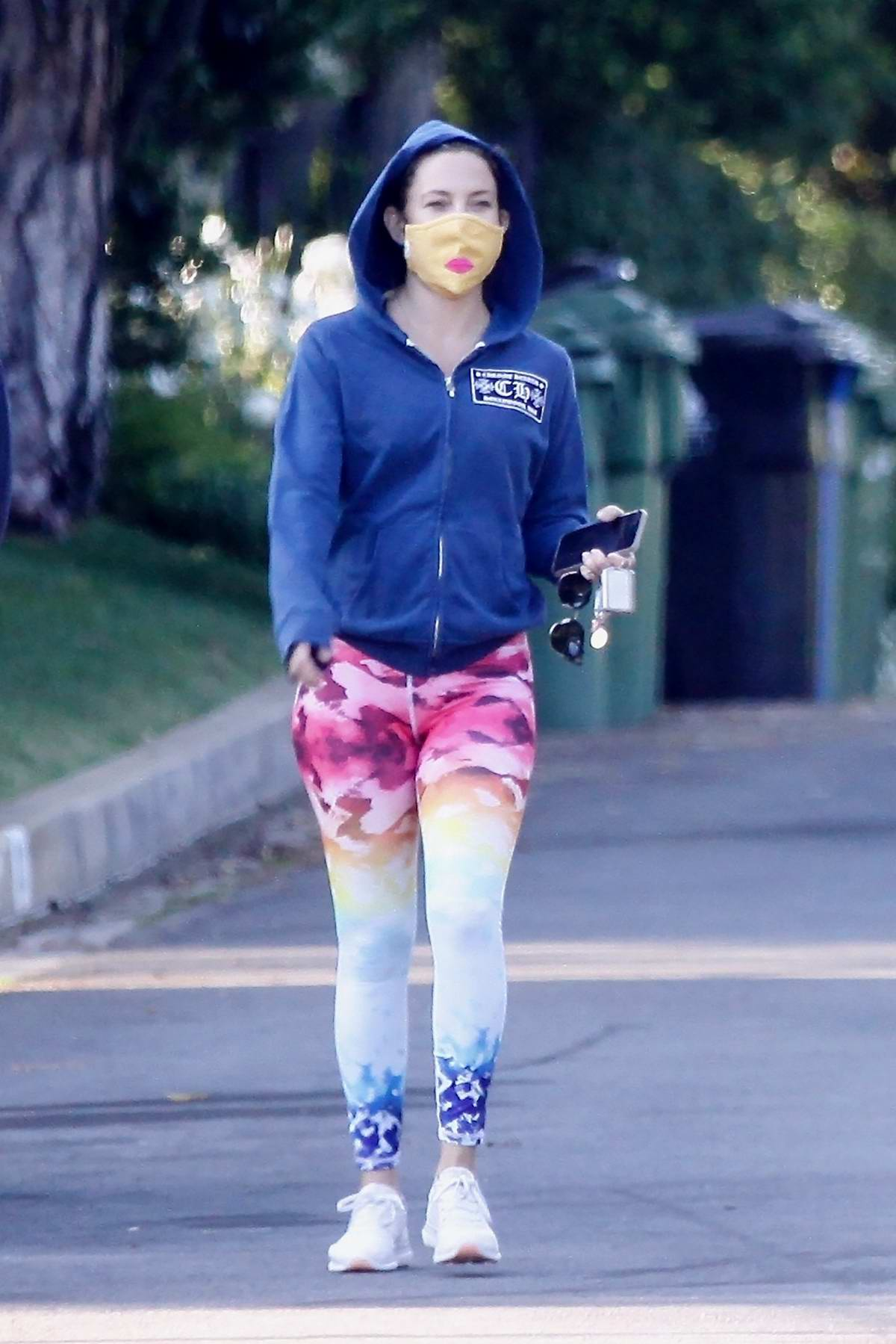 Kate Hudson rocks a pair of colorful leggings as she steps out for a walk with a friend in Brentwood, California