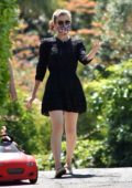 Kate Mara looks great in a black mini dress as she takes a walk with Jamie Bell and their daughter in Los Feliz, California